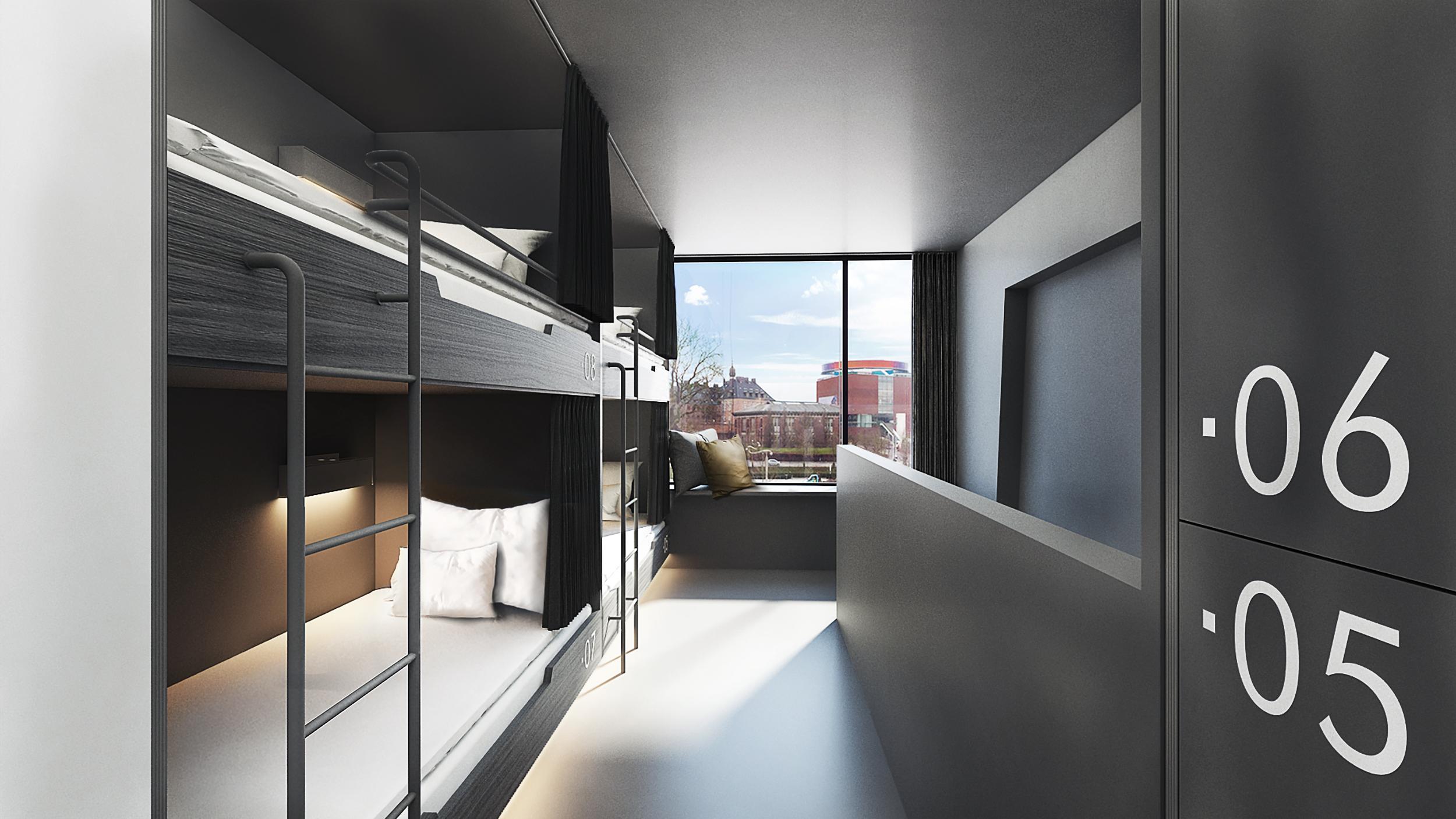 Eksempel på sovesal, pod dorm, som det kaldes, på Book1 Design Hostel, der åbner i Aarhus til marts næste år. Gennem vinduet anes Aarhus' kunstmuseum, Aros. Pressefoto: Brøchner Hotels.