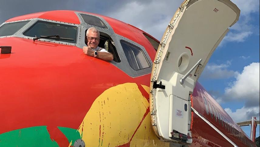 Jesper Rungholm i cockpittet på ét af sine DAT-fly, han er bestyrelsesformand for det nye rejsebureau Atlantis, som han og DAT ejer 50 procent af. Arkivpressefoto fra DAT.