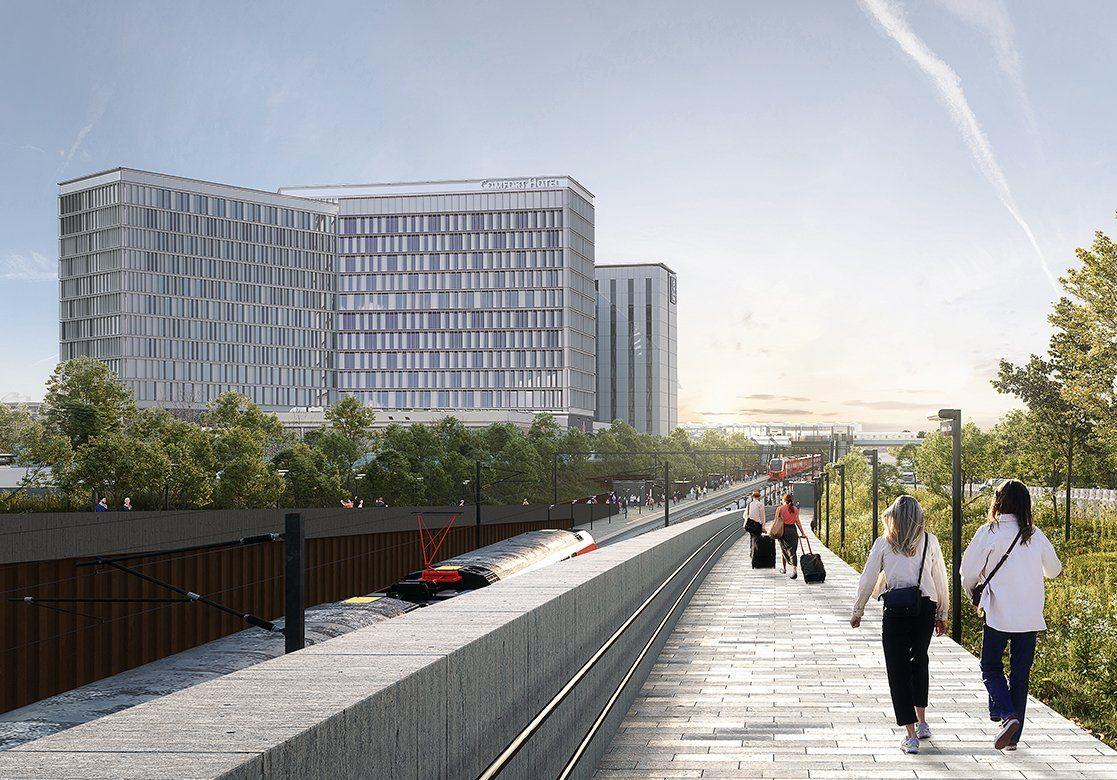 Visualisering fra Sund & Bælt af udvidelsen af stationen ved Københavns Lufthavn, der forventes klar i 2025 – i baggrund ses de nuværende Comfort- og Clarion-hoteller.